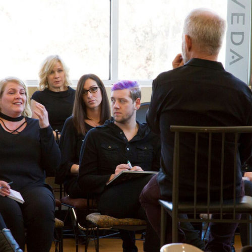 Photo of Lonny McLaughlin and the Shakti Team in a meeting